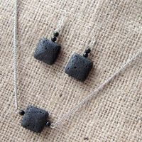 Black lava stone square silver earring & necklace set angled