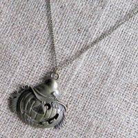 Bronze pumpkin Jack o'lantern necklace