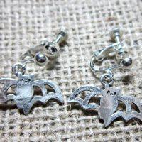 Cute flying bat silver clip on earrings