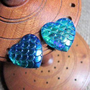 Dragon scale heart steel studs metallic blue green display
