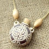 High fired celtic knotwork bottle necklace angled