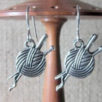 Knitting needles and wool silver earrings display
