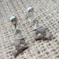 Mini witch on broomstick clip on earrings angled