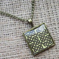 Square Celtic knotwork bronze necklace angled