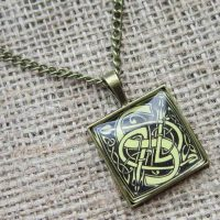 Square Celtic knotwork letter S bronze necklace angled