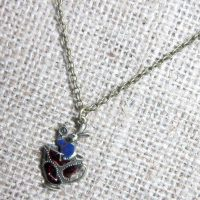 White rabbit in teacup bronze necklace