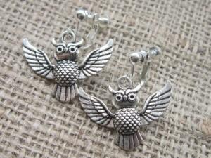 Silver flying owl clip on earrings
